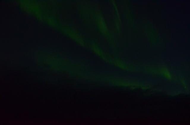 Northern lights dancing through the sky