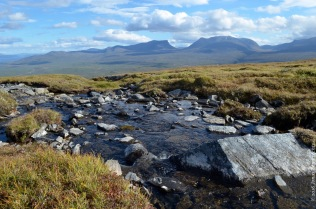 A little stream on top of the mountain, with a view on Lapporten, the gate to Lapland